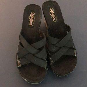Black Skechers wedge sandal